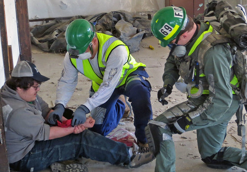 CERT students assess and treat  a simulated victim during the Spring 2013 final training exercise in Lorton, Virginia.