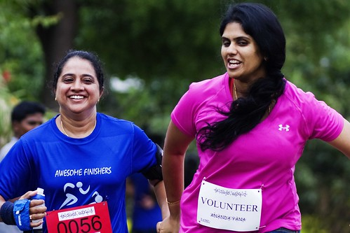 Volunteer helping fellow runner to complete the race