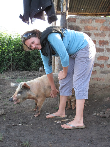 ILRI's Lian Thomas with pig in western Kenya