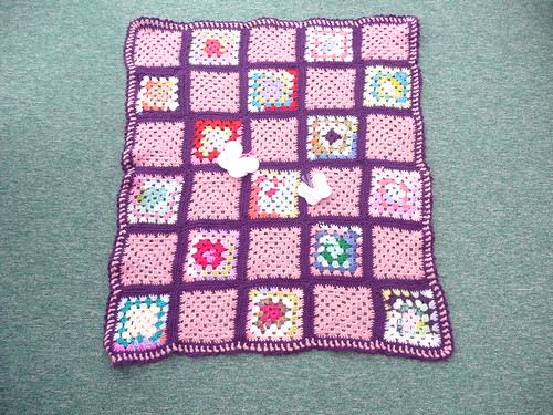 I love the purple yarn, it really makes the Squares stand out. Thank you very much!