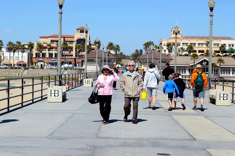 Parents walking along the pier