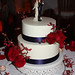 roses & James Story orchids navy ribbon wedding cake