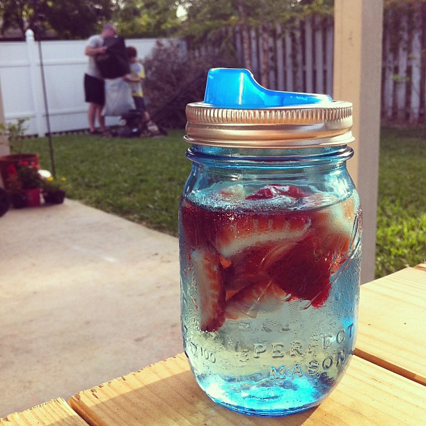 Strawberry infused water on a warm, sunny day. Two of my favorite boys working hard in the background. @cuppow #cuppow #jonahbonahgarden2013