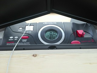 Treadmill console sitting on the standing desk