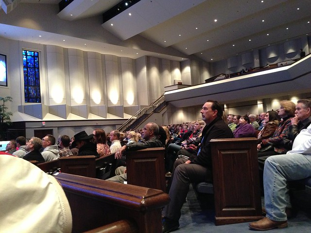 Attendees listening to Rich Van Pelt speaking at Crossings Community Church in OKC