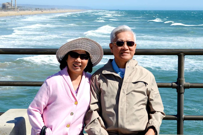 Parents on the windy pier