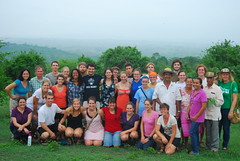 Group photo at Sembrandopaz farm, including MCC workers and Sembrandopaz organizers