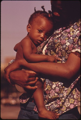A South Side Chicago Ghetto Mother And Child Who Live In Nearby Low Income Housing, 06/1973