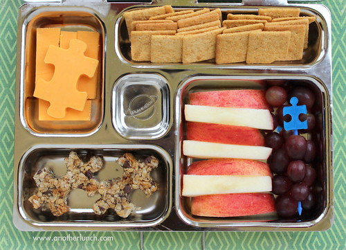 PlanetBox and puzzle pieces - granola bites, apples, grapes, crackers & cheese