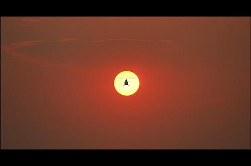 sunset silhouette helicopter dhaka bangladesh