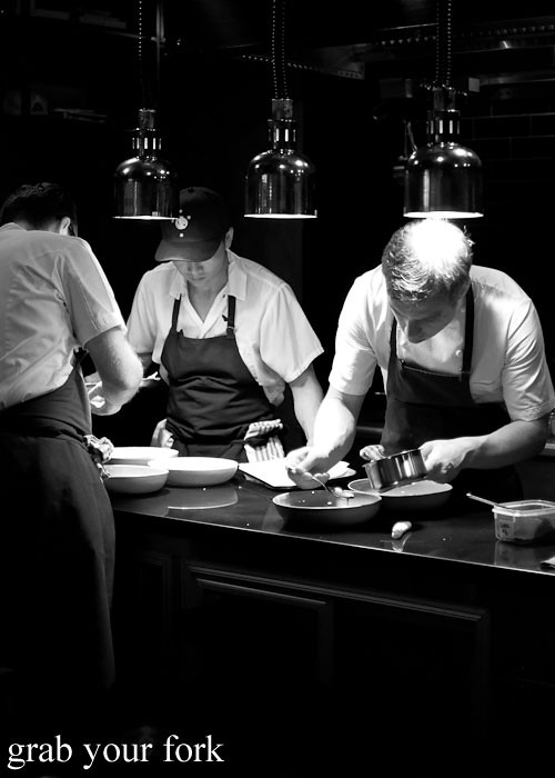 chefs plating at momofuku seiobo the star sydney