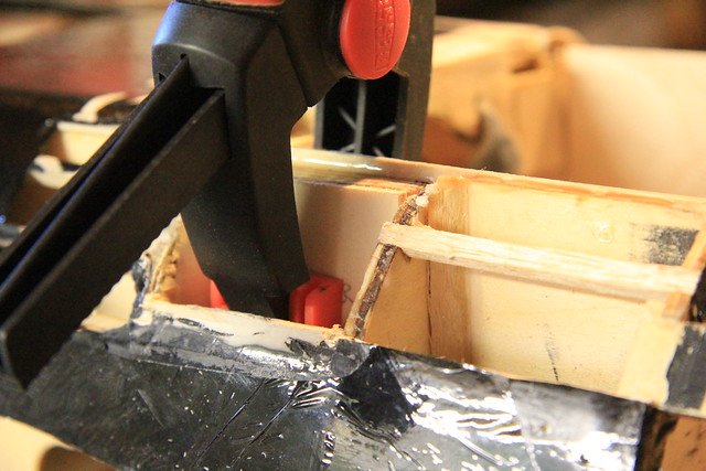 Port outer brace - clamped in place