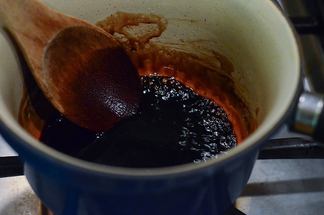 Balsamic vinegar boiling in a saucepan.