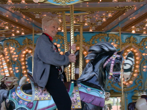 Mrs. Koch takes the first carousel ride