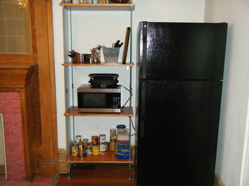 Finished shelves next to refrigerator