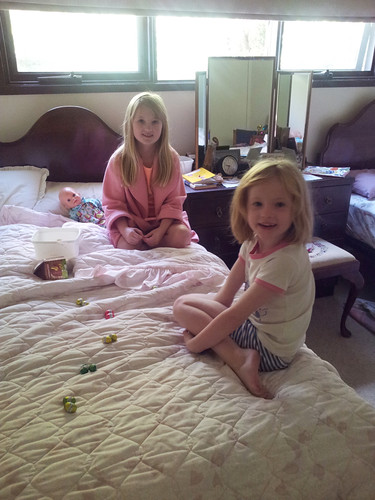 big sister teaching little sister division using easter eggs