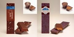 art(0.0), wood(0.0), chocolate bar(1.0), confectionery(1.0), brown(1.0), food(1.0), dessert(1.0), chocolate(1.0), brand(1.0),