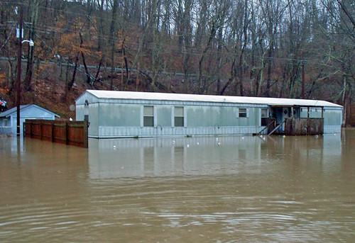 March 13, 2010 -- A trailer home badly flooded as a result of Dunloup Creek flooding. NRCS photo by Mark Bushman.