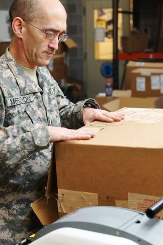 Sealing a box of supplies