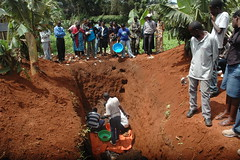Rwandan genocide survivors exhuming the bodies of their relatives killed and buried in a mass grave during the 1994 100-day massacre. Credit: Edwin Musoni/IPS