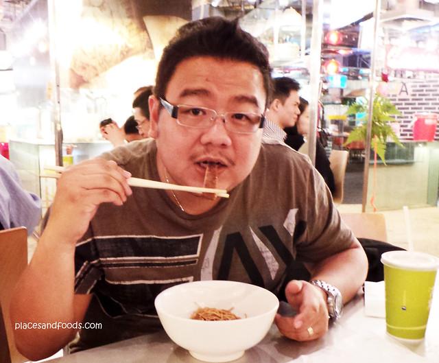 Tai Lei Loi Kei eating noodle