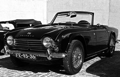race car, automobile, vehicle, triumph tr250, triumph tr5, performance car, automotive design, triumph tr4, antique car, classic car, vintage car, land vehicle, convertible, sports car,