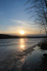 Setting Sun Over Frozen Lake