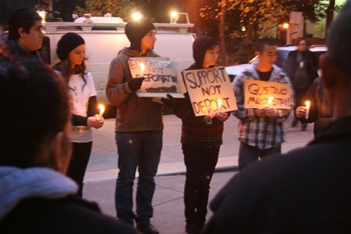 people at a candlelit protest for immigration reform