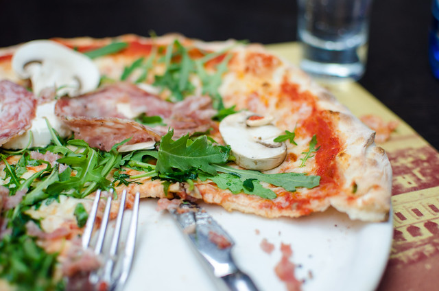 Use a knife and fork to dig into pizza in Venice.