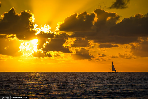 Sailboat-Sailing-Over-Atlantic-Ocean-During-Sunrise