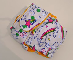 Bumstoppers One Size Hybrid Fitted Scribble Rainbow Yellow innerSnap down or  Fold over Rise