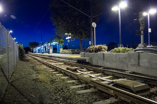 blue night train fence evening twilight tracks azure wideangle clear trainstation transportation commute rails siliconvalley mountainview tamron vta nasaames 18270 pzd