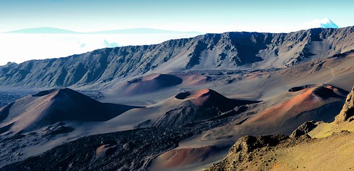 rogersmj posted a photo:	Several of the cinder cones in Haleakala crater on Maui, taken from a northern overlook point shorty after sunrise, shot from an average distance of around 1.5 miles away. I find it incredibly alien-looking. The hiking trail from the visitor's center can be seen leading to the one on the far right. The nearly 14,000-ft peaks of the Big Island -- Mauna Kea (left) and Mauna Loa (right), approximately 100 miles away -- can be seen on the horizon. Elevation at this point approximately 8500 feet.