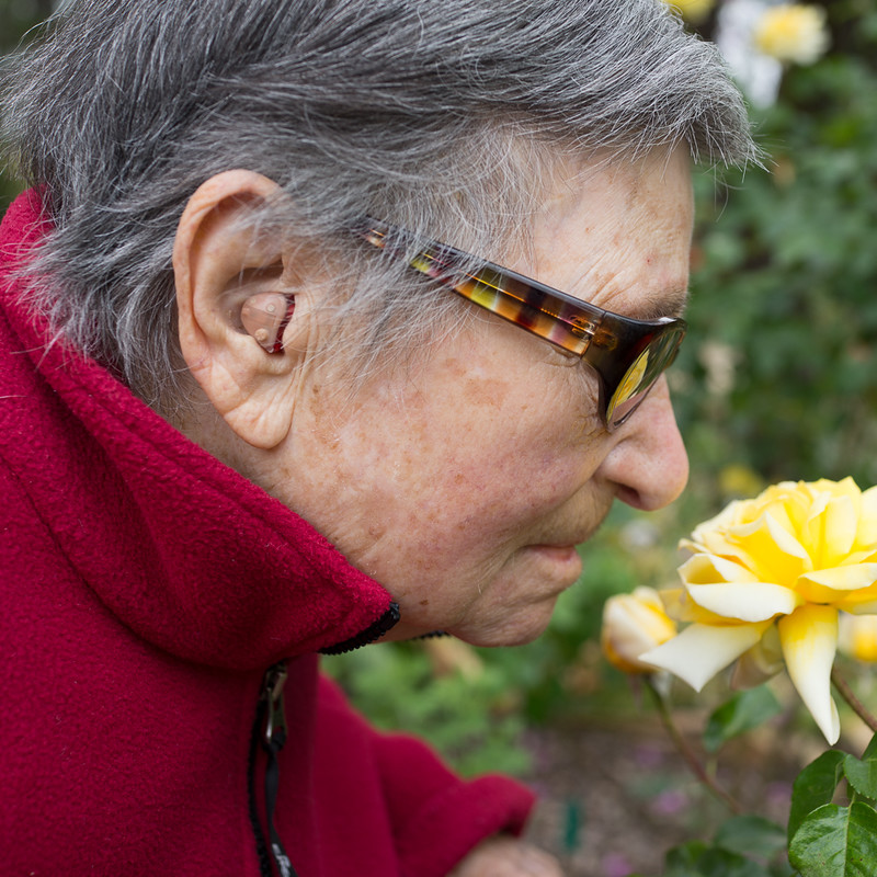 Frances smelling a rose
