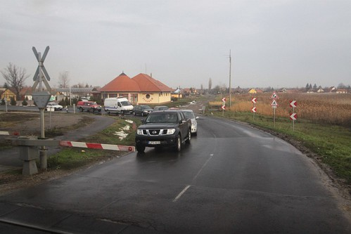 Cars wait at a Hungarian level crossing