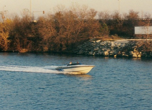 A westbound motor boat on the Chicago Sanitary and Ship Canal.  Lyons /  Summit  Illinois.  November 1989. by Eddie from Chicago