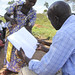 Representative of Farmer Group demonstrating record keeping a part of TAO's project in northern Uganda, 2013 by Trust for Africa's Orphans