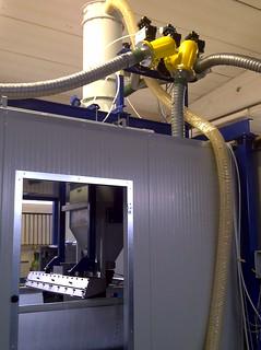 Sistema di aspirazione e dosaggio graniglia per rivestimenti edilizia