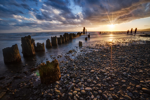 sunset sun seascape beach clouds canon landscape outdoors photography washington spring rocks northwest pacificnorthwest pugetsound pilings everett sunstar mukilteo picnicpoint 2013 michaelriffle