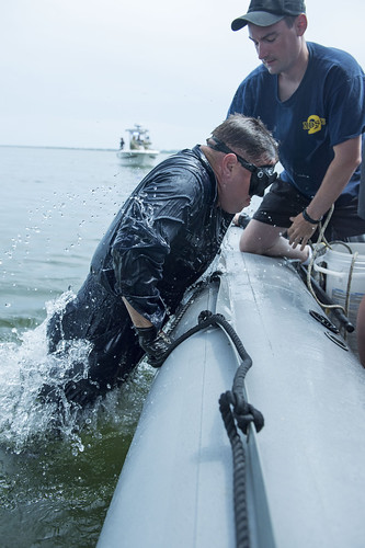 <p>U.S. Navy Diver 1st Class Shawn Gerasimchik, right, helps Navy Diver 1st Class Todd Verhagen, both with Mobile Diving and Salvage Unit (MDSU) 2, into a 7-meter rigid-hull inflatable boat in Parris Island, S.C., May 16, 2013, after a gross survey diving operation as part of Ardent Sentry 2013. The Beaufort County Sheriff's Office helped MDSU-2 search for people and vehicles following a simulated bridge collapse. Ardent Sentry is a NORAD and U.S. Northern Command (USNORTHCOM)-directed exercise focusing on defense support of civil authorities in response to simulated weather, security and disaster contingencies. While Ardent Sentry is primarily a command post exercise, several field training events were conducted at various locations within the USNORTHCOM area of responsibility. (DoD photo by Mass Communication Specialist 1st Class Dustin Q. Diaz, U.S. Navy/Released)</p>