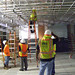 <p>Consultants were on-site to evaluate the rack system for overhead wiring in the second floor Data Center. photo by Larry Wiss</p>