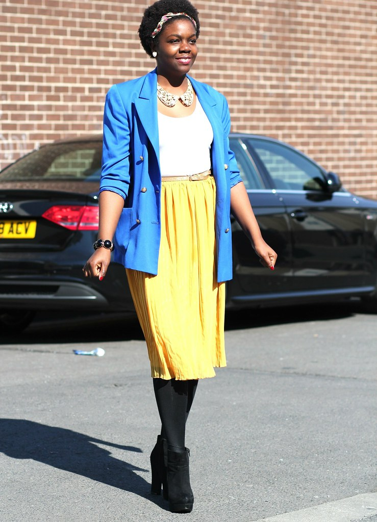 Yellow Accordion Pleat skirts, white top, Blue oversize double breast blazer & Peter Pan collar necklace, blue blazer with a yellow skirt, blue blazer with a yellow midi length skirt, blue blazer with a pleated skirt, long blue blazer with accordion skirt, ankle booties, black ankle booties, stocking with skirt, head accessory, accordion skirt, pleated skirt, accordion pleated skirt, midi length skirt, yellow skirt, yellow midi length skirt, long blazer, long blue blazer