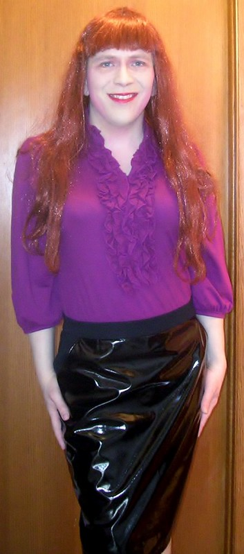 Standing in purple blouse and PVC skirt