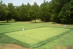 Sand in-fill golf green with synthetic fringe