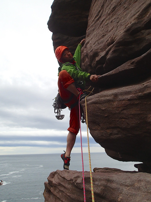 Wed, 2016-09-21 14:55 - Taken by Michelle. Masa (I) took ages to lead this pitch, as he had gone a way off-route to the right (VS 4b ish), then reversed back down half the pitch length, before going in the right direction to get to the belay ledge. Some moves in the first half of the pitch were I found 4c/5a, as opposed to the guidebook grade of 4b. In addition, there was no in-situ anchor in P2 belay. Plus, I spotted another in-situ belay far right. Therefore I went far right, but found the in-situ belay at the end is for abseil, and wasn't the one I had seen from the ground before the climb.  In the end I found the cave belay, as spotted earlier from the ground, but it just took ages.
