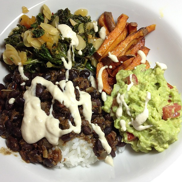 Dinner: rice and beans, cashew cream, kale sautéed with almonds and apricots, chili powder sweet potato fries, guacamole.  #vegan #glutenfree