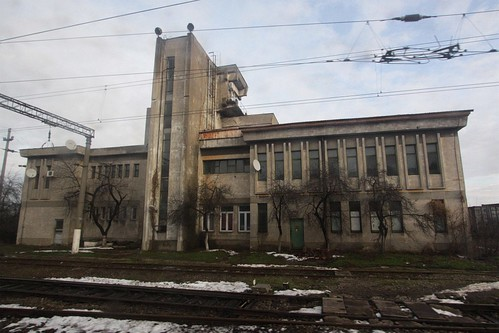 Crumbling concrete railway offices at Arad