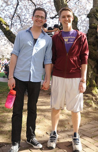 Holding hands, a sign of love in the spring, under the full cherry tree blossoms, University of Washington, Seattle, Washington, USA by Wonderlane