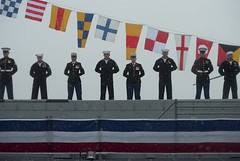 Sailors and Marines man the rails as the ship is brought to life during the commissioning of San Antonio-class amphibious transport dock ship USS Anchorage (LPD 23) at the Port of Anchorage, May 4. (U.S. Navy photo by Mass Communication Specialist 1st Class James R. Evans)