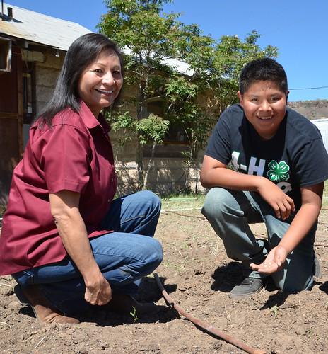 Millie Titla, NRCS district conservationist in San Carlos, Ariz., and her nephew Noah Titla work at the San Carlos 4-H Garden Club's community garden.